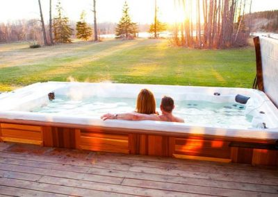 Couple looking at the sunset in the swim spa